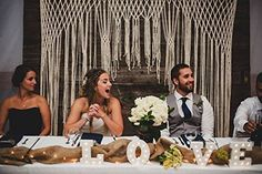 Large Macrame Wedding Ceremony Backdrop Arch for Arbor or Altar by The House Phoenix. This is a large and luxurious macrame wedding backdrop arch hanging that can be used on an arbor or an altar for indoor weddings or outdoor event backdrops. Use at your ceremony, reception, head table, cake table, in your wedding photos. It is a photographers dream backdrop and makes any photo look stunning. The hanging in the photos is 6 feet wide by 7 feet long or chose a larger width from the drop…