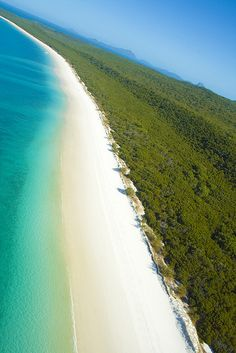 "Whitehaven Beach, Australia by natskis on Flickr. ""The sand is 99 % silica and the phenomena is caused by the silica sand bed that is in between the two beaches. The silica makes the sand almost pure white and it regulates the temperature of the sand so that it's comfortable to walk on even when it's a hot day."""