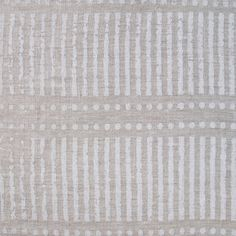 Dash Dot Chalk Linen. The crisp white on linen palette and linear pattern of this fabric celebrates Nordic simplicity and invigorates a plain rustic linen sofa. It has been hand block printed by a talented team of artisans using azo free pigments in the village of Sanganer, India. #whiteonwhite #fabric #drapery #light #design #stripes #spots