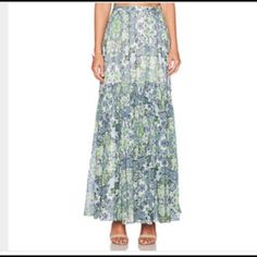 Marchesa Voyage silk maxi skirt Elegant silk skirt in blues and greens. One tier which slants toward the back. I bought this on the old Piperlime site, and have worn it once. I just don't have occasions to wear it, and someone should be enjoying it. It's pretty amazing! Marchesa Voyage Skirts Maxi