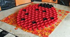 Ladybug game with cups-kids get a prize if they toss a ball and it lands in a black cup!  I could so make this for Adleigh's b-day party