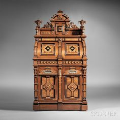 "Sold for $58,425 in July 2014. Wooton Renaissance Revival Walnut and Bird's-eye Maple Superior Grade Cabinet Secretary, last quarter 19th century, the cabinet with burl panels and part-ebonized and parcel-gilt details throughout, the superstructure with a central paneled arch flanked by carved eagles and urn-form finals, above a pair of half-domed paneled doors each centering a letter slot, one slot cast: ""MANUFACTURED BY THE/WOOTON DESK CO/Indianapolis, IND/PAT OCT 6, 1874,"""