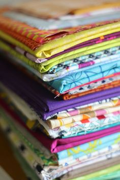 Essential Guide for Beginning to Sew: Beautiful Stack of Fabric - one thing you'll need (fabric that is) when learning to sew
