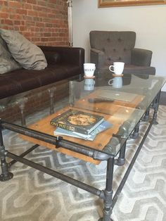 industrial iron pipe coffee table w. glass top and reclaimed wood