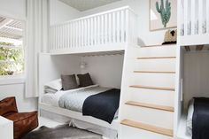 Beautiful bunk bed room with wallpaper on the ceiling. 'Contemporary luxe boho' holiday house by The Designory