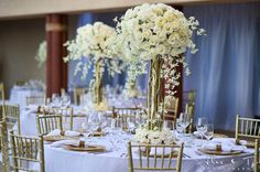 I like these centerpieces but with some blush pink added in. I want these gold Tiffany chairs.