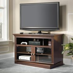 Have to have it. Bush New Haven Swivel TV Stand - Cherry $269.99