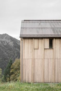 Larch-slatted shutters can be used to conceal the windows on Haus am Stürcherwald by Bernardo Bader