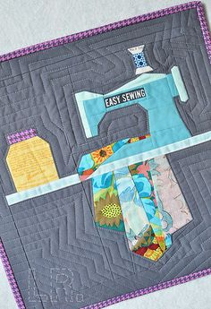 Paper Pieced Mini Quilt by LRstitched, via Flickr