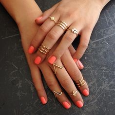 Coral nails & gold knuckle rings
