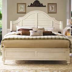 I am ashamed i like this, since it's Paula Deen, but the headboard curves on the sides to hold in pillows. Very interesting