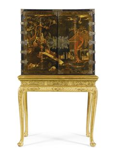 A GEORGE I BLACK JAPANNED CABINET ON A GILTWOOD STAND CIRCA 1720 the cabinet decorated with Chinoiserie scenes and with a pair of doors enclosing an arrangement of ten various drawers, on a giltwood stand ( re-gilded) with strapwork ornament, on turned legs with pad feet