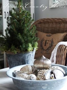 Love the mercury glass in galvanized bowl!! and the burlap pillow/wicker chair