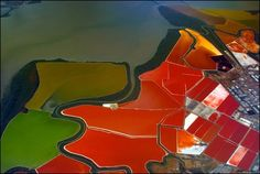 Using a radio-controlled camera attached to a kite, photographer Cris Benton documents spectacular aerial landscapes of vibrant salt ponds in San Francisco.