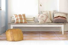Casablanca peach rug sitting pretty with our woven and shaggy cushions.