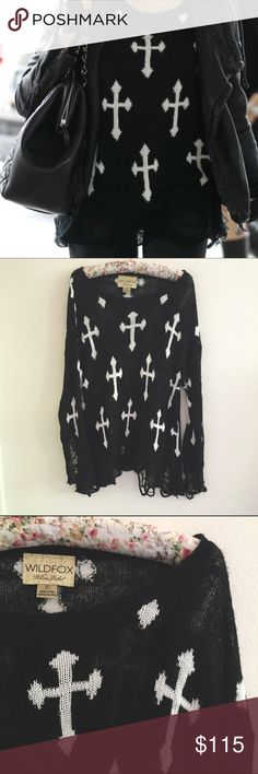 Wildfox Cross Print Oversized Sweater The perfect grunge oversized sweater by Wildfox. Featuring white crosses and ripped hems. Size extra small runs oversized in good preowned condition. YES to: Bundle Discounts NO to: Trades / Modeling / Holds  Happy Poshing!!  Wildfox Sweaters