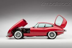 AUT 30 RK5112 01 - 1966 Jaguar XKE Coupe Red Engine Detail Profile View Studio - Kimballstock