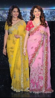 Madhuri Dixit in her canary coloured sari at the unveiling of her wax statue was eye-popping to say the least. Cotton Saree Designs, Silk Saree Blouse Designs, Beautiful Bollywood Actress, Most Beautiful Indian Actress, Indian Wedding Outfits, Indian Outfits, Wedding Sari, Indian Clothes, Modern Saree