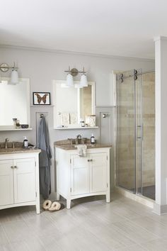 Update a dated bathroom with stylish vanity and fixture choices, and give your tub alcove a custom look with panels and a tile niche. Neutral accents finish this master bathroom remodel for a clean, modern decor.