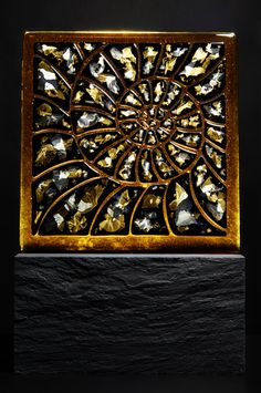 Spira Mirabilis 2007  Kiln formed glass with gold and silver leaf inclusions in a Slate base