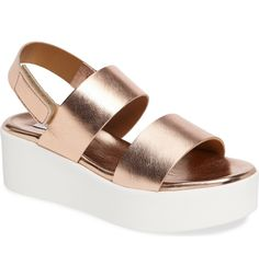 Minimalist yet modern. These on trend platform sandals with low wedge are simple yet bold.