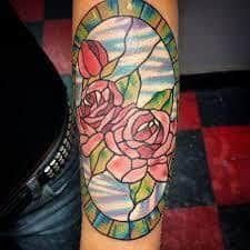 What does stained glass tattoo mean? We have stained glass tattoo ideas, designs, symbolism and we explain the meaning behind the tattoo. Stained Glass Tattoo, Stained Glass Flowers, Stained Glass Designs, Time Tattoos, Sleeve Tattoos, Unique Tattoos, Cool Tattoos, Ink Master Tattoos, Butterfly Tattoo Designs