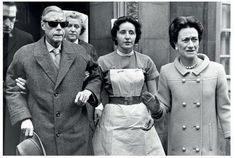 The Duke of Windsor, formerly King Edward VIII of England, leaves an eye clinic in London after an operation. He is accompanied by his wife the Duchess and nurses.