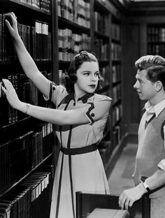 Strike up the Band (1940) with Rooney and Garland.  They SING in the LIBRARY.