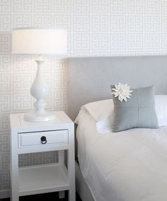 """Focus on texture. """"When you have a really monochromatic bed and everything feels very calm and toned down, you want something to be a focal point,"""" says Tineke Triggs of Artistic Designs for Living. """"This wallpaper brought texture and depth to the room."""""""