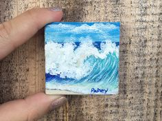 This is a super cute 2x2 acrylic wave painting I turned into a magnet by gluing a magnetic sheet on to the back of the canvas