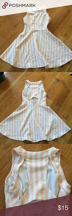 Forever 21 peach and white stripped dress In perfect condition, only worn 2 times. Size small. Super cute cut outs on the back! Flowy, pretty bottom. Very flattering dress 😊 size small! Forever 21 Dresses