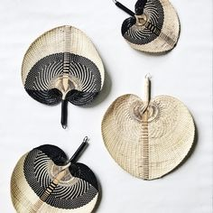 Equally at home on the wall or in hand on those balmy tropical nights, our handcrafted woven palm leaf fans are designed to transport you to a time when the living was easy... Available in two sizes and colours.