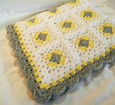 Handmade Lacy Granny Square Baby Blanket.  Color: Yellow, Silver Gray, and White.  Crocheted in a lacy granny square pattern & trimmed with a
