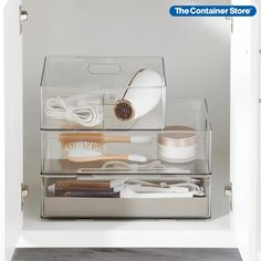 Created exclusively for The Container Store, this new collection celebrates our shared passion for multi-functional solutions that can maximize space in your bath. The Home Edit Hair Tool Trio with Heat-Resistant Tray Starter Kit includes staples from our exclusive product line from The Home Edit: (1) T.H.E. Stackable Hair Dryer Organizer, (1) T.H.E. Stackable Hair Tool Bin and (1) T.H.E. Silicone Hair Tool Holder Grey. Container Organization, Organization Station, Bathroom Organization, Hair Dryer Organizer, Over The Door Hanger, Hair Accessories Holder, Reach In Closet, The Home Edit, Shower Soap