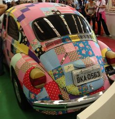 Patchwork car...Love it.   I want aPatch  PT Cruiser