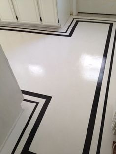 Painted floor mostly white with black line trim - love this look for a kitchen floor