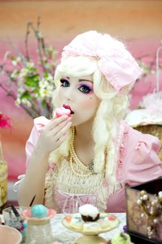 Marie Antoinette Doll Makeup. Also makes me think of Alice in Wonderland :D I think it's the cakes!
