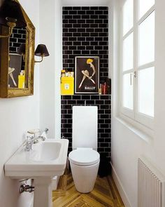 I like the way the toilet is framed out. Maybe create an effect like this with the cabinet?