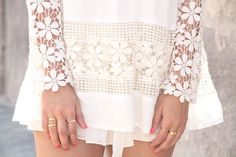 White summer dress with flower embroidery.