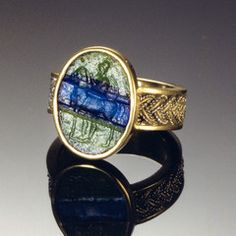 This beautiful intaglio is carved in a piece of bright blue and green striped mosaic glass, formed by laminating individual pieces in separate colors under great heat which causes them to fuse togethe Roman Jewelry, Men's Jewelry, Jewelery, Fine Jewelry, Jewelry Design, Or Antique, Antique Rings, Antique Jewelry, Vintage Jewelry