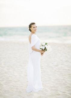 NK Photography Beach wedding photography of the bride.
