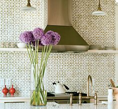 This is my favorite kitchen tile, I love how the white glaze shines against the natural ceramic.  Have to have it in the new kitchen!