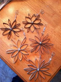 snowflake ornaments made from paper towel and paper towel rolls