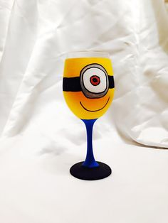 Minion from Despicable Me inspired Hand Painted by AWhimsicalHoot Diy Wine Glasses, Decorated Wine Glasses, Hand Painted Wine Glasses, Wine Glass Crafts, Wine Bottle Crafts, Wine Bottles, Wine Painting, Bottle Painting, Pebeo Porcelaine 150