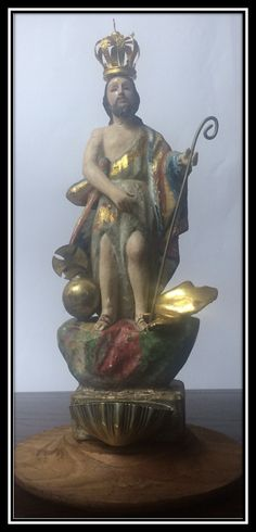 This is a late 18th century Brazilian figure of Saint Joseph which is carved from one solid block of Brazilian light wood in the Baroque style and comes with a separately carved base.  St. Joseph is gilded and hand painted and comes with French glass eyes, a crown, an ecclesiastical ball which represents Christianity in the world, a gold staff and a silver half shell which is a connotation for purity and chastity as receptacle for holy water.  A very special piece