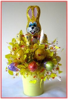 """BUNNY HOP"" A chocolate Bunny surrounded with 21pcs of Easter character milk chocolates and eggs, adorned with colourful cellophane, nested in a pink Easter bucket. A lovely Easter gift!"