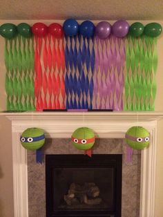 Streamer/balloon decoration with green lantern ninja turtles.