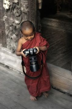 A young Buddhist monk begging for his daily meal