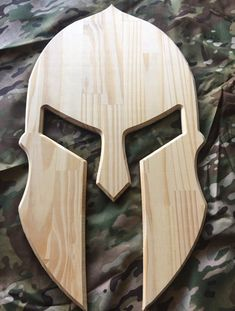 Wooden Spartan Helmet Plain Spartan Helmet design out of pine wood. Approximate size: x Easy to hang with a sawtooth picture hanger on the back. Can also add custom engraving or design Wood Shop Projects, Small Wood Projects, Woodworking Projects Diy, Woodworking Patterns, Woodworking Jointer, Woodworking Apron, Router Woodworking, Woodworking Magazine, Woodworking Techniques