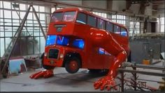 Red London bus does push-ups